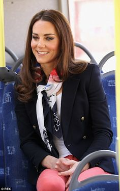 French twist: The Duchess channelled Parisian chic with a silk scarf, tailored…