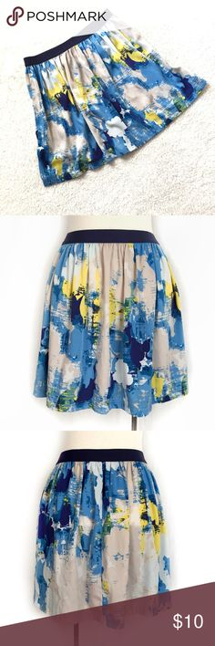 "Joe Fresh Print Pull-On Flare Skirt Fun watercolor print skirt with shades of blue mixed with neutrals and splashes of yellow. Pull-on style with elastic waistband. Unlined. 100% polyester. Machine wash. Size Small. Waist: 14"" flat across, unstretched. Length: 17.5"". EUC. Thanks for looking! Joe Fresh Skirts"