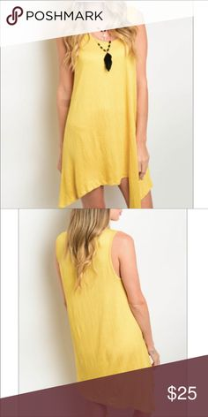 Asymmetrical Sleeveless Mini Dress Beautiful yellow jersey knit dress. Scooped neck, Asymmetrical hem rayon polyester blend. Length approx 37 Inches Dresses Mini