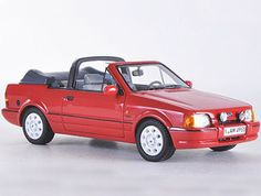 Neo Ford Escort Resin Model Car 44955 This Ford Escort Convertible Resin Model Car is Red and features comes in a display case. It is made by Neo and is scale (approx. Convertible, Ford Escort, Model Car, Ford Models, Diecast Models, Display Case, Scale Models, Childhood Memories, Resin
