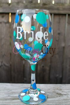 A personal favorite from my Etsy shop https://www.etsy.com/listing/110694477/personalized-bride-wine-glass-20-oz