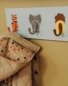 DIY Animal Hooks Decorate a baby& nursery with this wildly adorable coat rack. To add texture, like fur, to your creatures, apply paint over the base coat using a stippling brush. Deco Jungle, Jungle Room, Safari Room, Jungle Theme Nursery, Themed Nursery, Jungle Safari, Noahs Ark Nursery, Diy Coat Rack, Coat Hanger