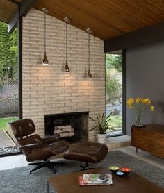 beautiful Mid Century modern fireplace, especially the light fixtures. Rejuvenation, I believe.  FOR ED?