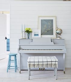 """""""I'm almost always painting something white, blue, or turquoise,"""" Amanda says. Proof: the 1970 piano she painted a soothing gray-blue (Paris Gray by Annie Sloan Chalk Paint) so that it would better blend into the space. Now that the bulk of the home renovation is complete, the family has a new project on the horizon: """"A really awesome fort,"""" says Ethan. - CountryLiving.com"""