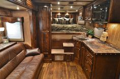 A comfortable, cozy layout to add to your next 4-Star Trailers LQ. This one from Outlaw Conversions. (800) 848-3095