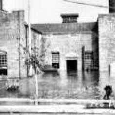 Old ice house on First Street showing flood reaching building in 1942.
