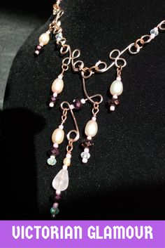 This elegant necklace is created with a rose quartz drop at the center of the necklace, topped with a tiny pink pearl. Each additional drop is fashioned with a  luminous peachy pearl, accented by clear and purple crystals. Each bead is accented by a tiny pink seed bead. The delicate links in this design are created with rose gold enameled copper wire. The necklace ties with pink satin ribbon. Part of a set. More at: www.adornwithelegance.etsy.com