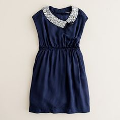 This is a great silhouette for a little girl's dress - I bet you could cut this out as a rectangle - top width = shoulder to shoulder - round neck - button loop on back - tie at waist.  I need to try to find the right material for this!