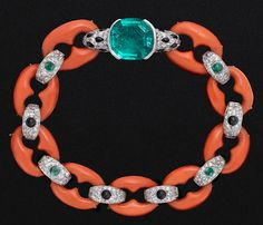c1922 Coral,Emerald,Diamond Bracelet.....Cartier Paris, 1922. Platinum, coral, cushion-shaped emerald, collet-set emerald and onyx cabochons, pave-set diamonds.