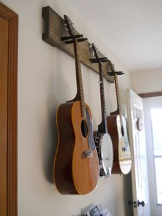 DIY guitar hanger - simple & secure! We practice so much more since we've put this up.