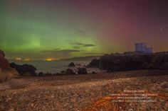 Aurora over the castles Isle of Doagh Inishowen with Fanad Head in the distance.