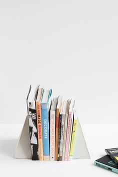 How to: Make DIY Geometric Concrete Bookends with Scrap Cardboard » Curbly | DIY Design & Decor