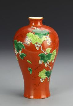 China, 19th C., Famille Rose Meiping vase, colorful grape vine scrolled around the body against a bright red background, Qianlong mark on base. Height 6 in.