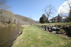 charming riverfront farmhouse, noted by the Dept of Interior as Watauga county's oldest house.