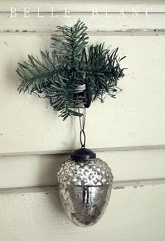 Spruce and metallic bauble hanging