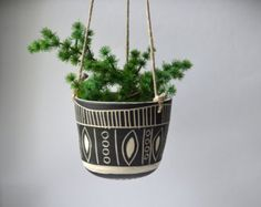 This hanging planter is wheel thrown and hand carved. This listing is made to order and will take 2-4 weeks to ship. Measures about 4X5 inches.