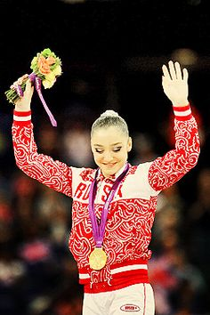 Gold looks fantastic on Musty! I think her story is far more inspirational than Gabby Douglas'. Torn ACL, worked like hell to get back to form, won an Olympic gold, and is still going straight back to training. What a gymnast.