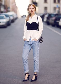 White button up shirt with black bustier layered over the top and killer black heels