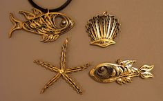 Make these scallop shell and starfish necklace pendants from gold-edge paper - yes, paper!