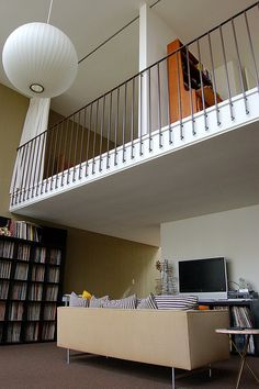 IKEA Expedit bookcase stores a vinyl collection in this 1957 atomic ranch living room by Ed Killingswoth. Railing too. Living Room Fans, Living Area, Ikea Expedit Bookcase, Two Bedroom, Bedrooms, Vinyl Railing, Atomic Ranch, House Yard, Attic Renovation