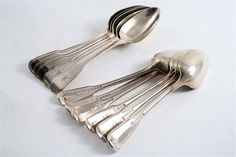 FIDDLE, THREAD and DROP PATTERN TABLE SPOONS: A George III matched set of nine table spoons by W. Eley & W. Fearn, London 1799/1802/1805