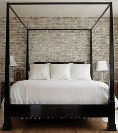 white washed brick wall in the bedroom.  just behind the bed as an accent wall...