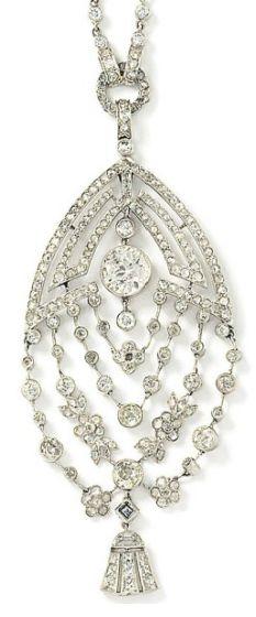 An Art Deco diamond pendant necklace The openwork pendant of navette-shaped outline, the quadruple swag of old brilliant-cut diamonds and rose-cut diamond floral motifs, and tassel-shaped drop, to a rose-cut diamond geometric design surmount with old brilliant-cut diamond collet centre, suspended from an old-cut diamond collet line necklace, circa 1920, necklace 63.0cm long, pendant 9.0cm long