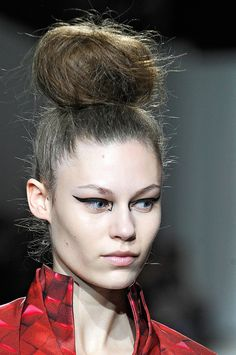 The uber pre-teased and nest formatted up high bun - Mary Katrantzou A/W12-13 LFW