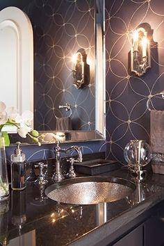 There is just something inherently elegant about a gleaming bathroom with dark walls...