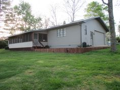 Private and secluded on blacktop12.40 ac close to town with rural water Great for horses or cattle.Attractive 3 b/r 2 bath maintenance-free rancher -fully equipped kitchen -utility room-Andersen windows-metal roof-and dual fuel C/H/A- 18x30 screened -in deck and oversized 2 car attached garage. RV carport and 30x40 shop/barn with electric and water in West Plains MO
