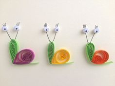 Snails on cream background, quilled art, greeting card, blank card, insects, animals.    Quilling is a technique of rolling up thin strips of paper