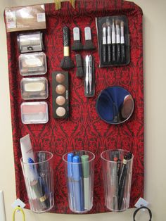 My version of the make-up holders I've seen on Pinterest.  I justed a cookie sheet. Using spray glue I added a handkechief (Hobby Lobby) and 3 small clear plastic glasses (Walmart) and added magnet strips to all make-up.  Used extra long magnet strips for glasses.  Looks good in bathroom and a very useful item.
