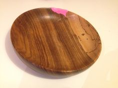 I made this bowl in high school. Sadly it got dropped and the piece from the rim got lost. So repaired it kintsugi style with Milliput, stained with ink. Repaired! Funky style.