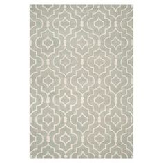 Wool rug with a grey and ivory quatrefoil lattice motif. Hand-tufted in India.  Product: RugConstruction Material: 100% WoolColor: Grey and ivoryFeatures:  Made in IndiaHand-tufted Note: Please be aware that actual colors may vary from those shown on your screen. Accent rugs may also not show the entire pattern that the corresponding area rugs have.Cleaning and Care: Professional cleaning recommended