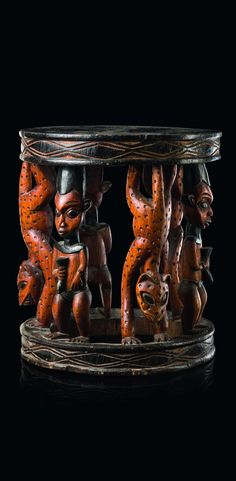 Africa   Stool from the Bamileke people of the Cameroon Grassfields   Wood; middle brown patina, with black and yellow pigment.  H:  55 cm