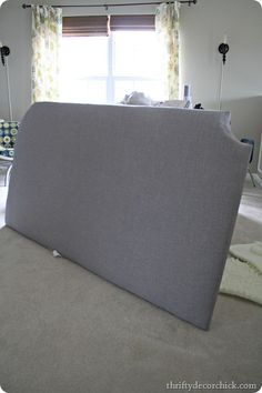 DIY upholstered headboard using 2 egg crate mattress pads -  look for the XL twin sizes after back to school – you can find them for cheap!