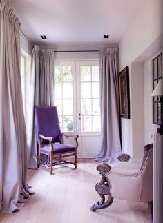 I love the feeling this room evokes and the soft lavender of the curtains. :)