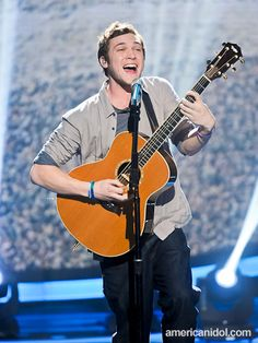 """Phillip Phillips performs """"Movin' Out"""" by Billy Joel at the Top 10 performance show."""