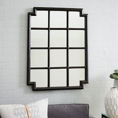 """Notched Wall Mirror  $269  24""""w x 2""""d x 31""""h. Solid wood frame, mirrored glass."""