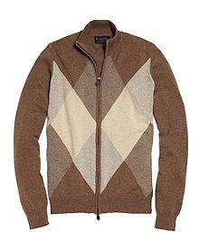 It's been over 60 years since former Brooks Brothers president, John Clark Wood discovered the argyle pattern while attending a golf match on holiday in Scotland. Today, we are pleased to offer this full zip sweater with an oversized argyle pattern made from three-ply cashmere, spun in Scotland, at Todd & Duncan mill. Features warm fall colors and ribbing at the collar, cuffs and hem. Dry clean. Made in Scotland.