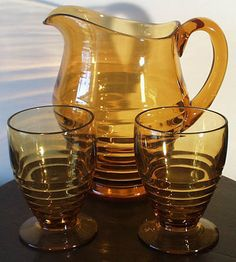 Amber Depression Glass Pitcher And 2 Water Glasses.  Since these are not signed, could be Penny Line by Paden City or Ripple by Duncan & Miller.