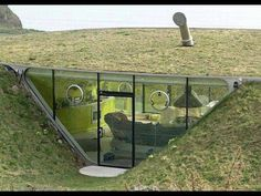 Woman builds her own Hobbit hole house under a hill.