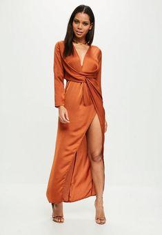 Rust orange satiny dress with plunge V neck, long sleeves, twisted design, front slit and back hidden zip.