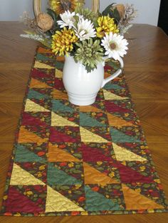 Fall is right around the corner, are you ready? This runner would be a beautiful addition to any table. Its made using a variety of fabrics in