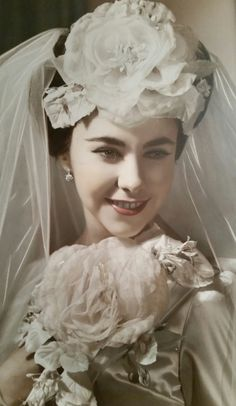 A wedding day in 1945. This is awesome...are we inspired today by the flowers in the hair?!