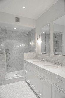"6"" X 12"" polished white Carrara honed Poreclein on walls, hexagonal honed finished on floors bathroom tile."