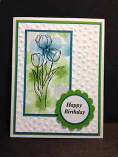 handmade Easter card ... clean and simple design ... luv the outline only of the tulips stamped over designer paper with soft watercolor look flowers ... Stampin'Up!