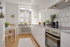my scandinavian home: Cool grey and brass in a Gothenburg home