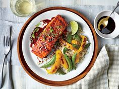 Molasses-Soy Glazed Salmon and Vegetables Recipe | In just 35 minutes, you can serve your family this incredibly delicious and good-for-you seafood supper. When it comes to busy weeknight dinners, quick and easy is the name of the game; and this tangy salmon with savory roasted vegetables is both full of flavor and hearty enough to satisfy the whole family. Make sure to cut the vegetables in similar sized pieces so they cook in the same amount of time.