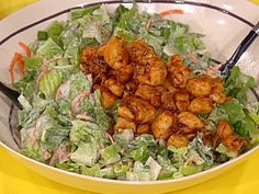Food Network invites you to try this Buffalo Chicken Salad recipe from Rachael Ray.